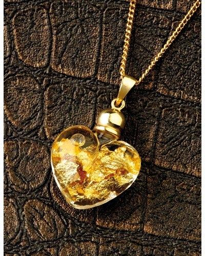 collier avec fiole d'or en forme de coeur