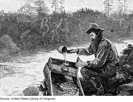 pionnier qui nettoie du gravier dans sa rampe
